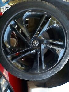 Vauxhall Corsa E black alloy wheel and tyre 215/45/17 No1