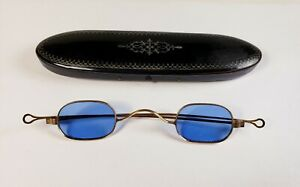 Hallmarked solid 10K gold spectacles. Blue lens antique eyeglasses with case.