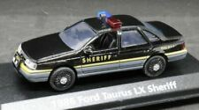 Motormax 1/43 1986 Ford Taurus LX Sheriff Police Car w/ Display Case 73845