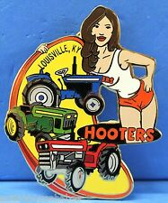 HOOTERS SEXY GIRL WITH 3 TRACTORS FARM LAND LOUISVILLE, KY KENTUCKY LAPEL PIN