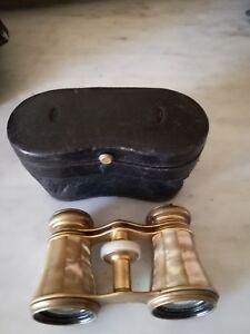Elegante binocolo da teatro antico in ottone e madreperla. Fine 800 funzionante!