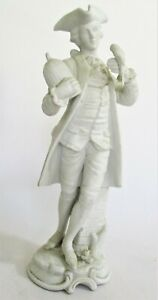 Parian Ware Figurine of a Gentleman in a Frock Coat Holding a Bird & Cage