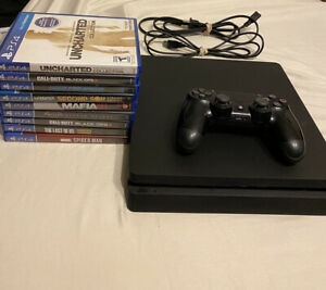 Sony PlayStation 4 Slim 500GB Bundle, includes 9 games and controller.