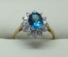 Beautiful 9 carat Gold Blue Topaz And Cubic Zirconia Cluster Ring Size N