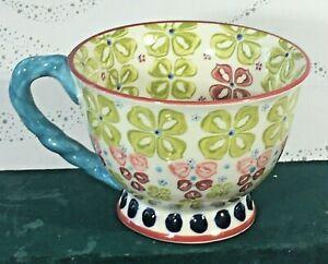 Anthropologie footed Mug floral - detailed green w/ blue twist handle Ceramic