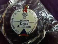 DELTA AIRLINES Round Olympic Pin Still Sealed/Never opened