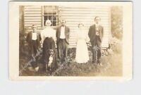 RPPC REAL PHOTO POSTCARD FAMILY PHOTO IN FRONT OF HOUSE WITH DOG
