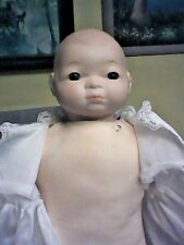 Bye Lo Type Baby Doll with Bisque Head Glass eyes and large cloth stuffed body