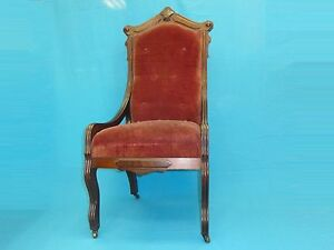 ANTIQUE VICTORIAN 19 .c RED VELVET EASTLAKE TUFTED CHAIR with BRASS ROLLERS