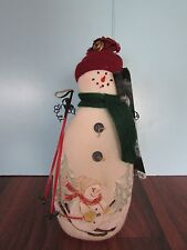 """10"""" with wooden skies and painted on scene plush little stuffed snowman"""