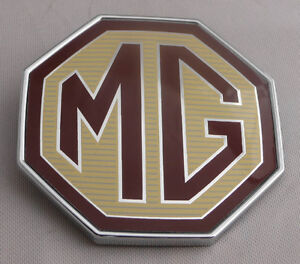 MG TF FRONT OR  REAR BADGE, NEW BUT SHOP SOILED, GENUINE (DAB000160SS)