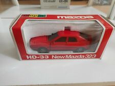 Yonezawa Diapet New Mazda 323 in red on 1:40 in Box