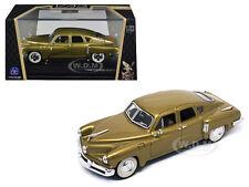 1948 TUCKER TORPEDO GOLD SIGNATURE SERIES 1/43 DIECAST BY ROAD SIGNATURE 43201