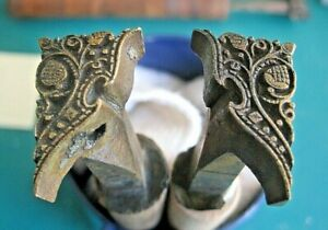 Bookbinding: rare pair of brass decorative corner stamps, possibly 17th century