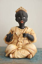 A c19th Porcelain Seated Oriental Figure with Nodding Head & Articulated Tongue