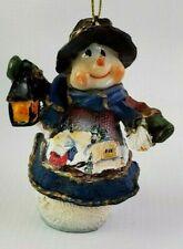 Snowman Wearing Sweater w/ Town Scene holding Lantern Christmas Ornament