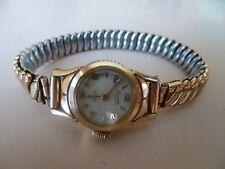 Ancienne petite montre femme mécanique dorée   LACORDA   bracelet extensible