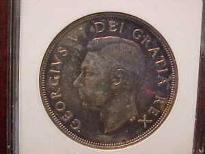 1949 Canadian Dollar certified MS65 with great color!!!!!