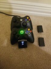 2 Genuine Authentic Xbox 360 Wireless Controllers & nyko charger and batteries