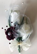 Buttonhole with burgundy Ivory Roses, crystal spray