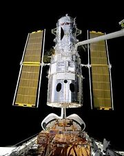 Hubble Space Telescope deployed by Shuttle Discovery after service Photo Print