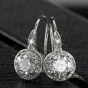 18k gold earrings made with swarovski crystal stud gp hook back