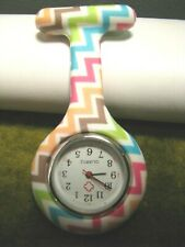 NURSES SILICONE WATCH PIN MULTI-COLOR ZIG-ZAGS, ON WHITE HANGS-3-1/2 INCH-LONG