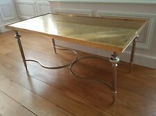Table de salon bronze doré et métal, verre feuille d'or , pieds réglables, 1940