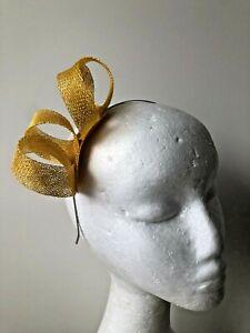 New yellow loop fascinator on a silver metal headband