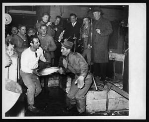 Louis De Marco,Michael Tolento doing the twist with a fish,Fulton Fish Mar 2916