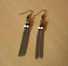 Bronskleurige lange dubbele ketting oorbellen met wit en bruin steentje  NIEUW