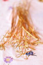 100x elastische Geschenkschleife Zier Gummiband gold , ca. 28cm Durchmesser