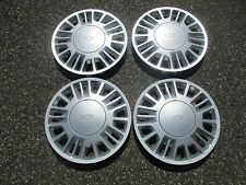 Genuine 2000 to 2004 Chevy Malibu 15 inch bolt on hubcaps wheel covers set