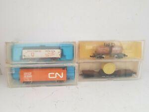 4 x N SCALE / N GAUGE FREIGHT CARS BY VARIOUS MAKERS.