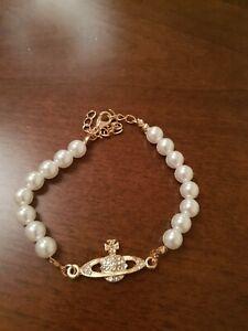 Gold Saturn Orb Pearl Bracelet