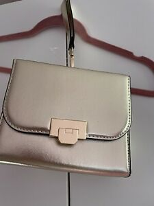 New Nwt - Small Gold Handbag With Wrist Loop And Long Chain Strap