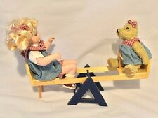 COLLECTIBLE PORCELAIN DOLL WITH BEAR & TEETER TOTTER GEPPEDDO