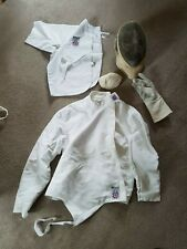 Adult male sporting fencing equipment