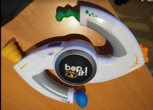 White Bop It! XT Electronic Handheld Toy by Hasbro.  Working with Battery