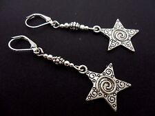 A PAIR OF TIBETAN SILVER DANGLY STAR THEMED LEVERBACK HOOK EARRINGS. NEW.