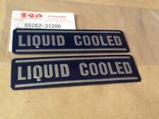 SUZUKI GT750 WATER BUFFALO KETTLE PAIR LIQUID COOLED EMBLEM DECALS NOS GENUINE