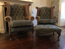 A pair of Queen Anne wing back chairs, footstool in Harris tweed&vintage leather
