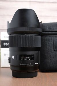 Sigma 35mm f/1.4 DG HSM Art Lens for Sony A-Mount with Hood, Caps, Bag and Box