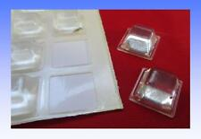 A SET OF 40 CLEAR POLYURETHANE STICK ON SQUARE RUBBER FEET 12 mm.  X  12 mm.
