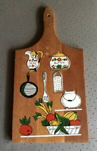 Small wood chopping board with pictures on front