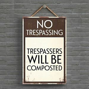 TRESPASSERS WILL BE COMPOSTED TYPOGRAPHY SIGN PRINTED ONTO A PLAQUE
