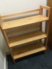 Six folding wooden bookcase units, stackable and lightweight.