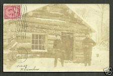 Quebec rppc Men Guns Hunters Hut QC Canada stamp 1901