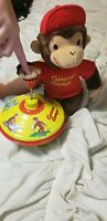 Curious George Tin spinning top and plush stuffed animal