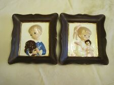 TWO CERAMIC PICTURES OF A BOY WITH DOG  AND GIRL WITH DOLL